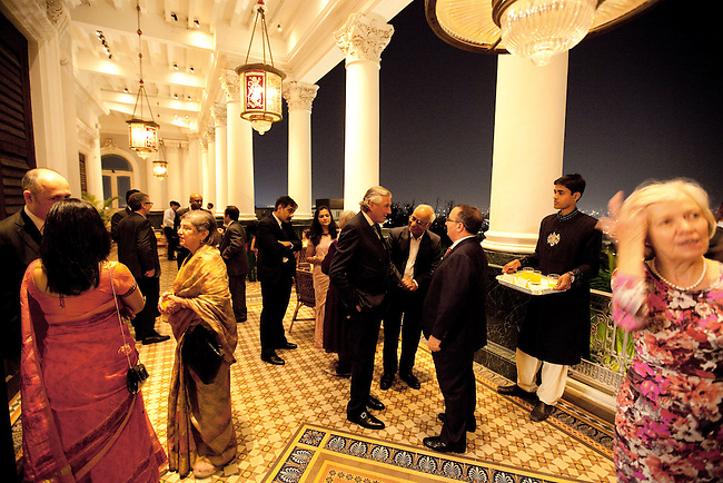 02 Feburary 2013, Hyderabad, India:  Guests mingle for pre dinner drinks before the OzFest sponsored dinner featuring Australian chef Christine Manfield, of Universal restaurant, Sydney  who cooked a five course meal for guests at the Falaknuma Palace at Hyderabad , India. The dinner also featured Australian author John Zubrzycki who read excerps from his latest novel The Mysterious Mr. Jacob to the crowd of Australian and Indian dignitaries and businessmen. Picture by Graham Crouch