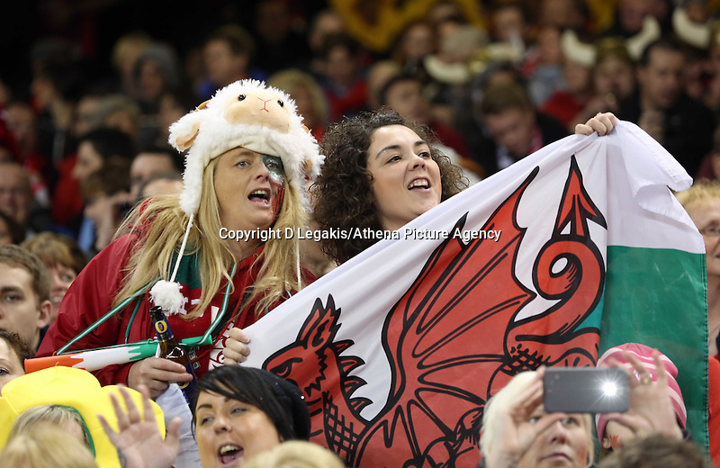 Pictured: Two women Wales supporters with a flag. Saturday 15 November 2014<br /> Re: Dove Men Series rugby, Wales v Fiji at the Millennium Stadium, Cardiff, south Wales, UK.