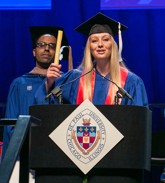 Sandra Berkhia, Class of 2008, reads the alumni induction at the DePaul University's Driehaus College of Business commencement ceremony, Sunday, June 12, 2016, at the Allstate Arena in Rosemont, IL, Some 1,400 students received their degrees. The Rev. Dennis H. Holtschneider, C.M., president of DePaul, conferred the degrees. Kathy N. Waller, executive vice president and chief financial officer, The Coca-Cola Company, addressed the graduating class and received an honorary degree. Joseph A. McInerney, hospitality industry leader and author, also received an honorary degree. (DePaul University/Jamie Moncrief)