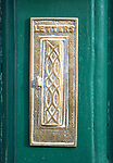 Historic brass letter box on door, Devizes, Wiltshire, England, UK