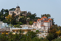 Athens, Greece. View from Areopagus below the Acropolis.  The National Observatory of Athens and Agia Marina church.