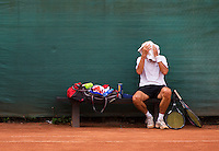 2013,August 21,Netherlands, Amstelveen,  TV de Kegel, Tennis, NVK 2013, National Veterans Tennis Championships,   Changeover,towel,resting<br /> Photo: Henk Koster
