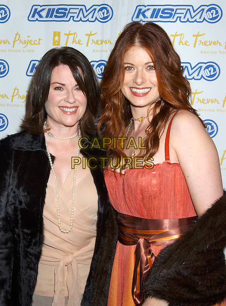 "MEGAN MULLALLY & DEBRA MESSING.were honoured at the Trevor Project's ""Cracked XMAS 7"" held at the Wiltern LG,  Los Angeles, California, USA, .December 5th 2005. .half length.Ref: ADM.www.capitalpictures.com.sales@capitalpictures.com.©Laura Farr/AdMedia/Capital Pictures ."