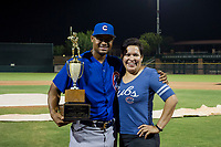 AZL Cubs assistant hitting coach Leonel Perez (66) holds the Chuck Jared Championship Cup after winning Game Three of the Arizona League Championship Series against the AZL Giants on September 7, 2017 at Scottsdale Stadium in Scottsdale, Arizona. AZL Cubs defeated the AZL Giants 13-3 to win the series two games to one. (Zachary Lucy/Four Seam Images)