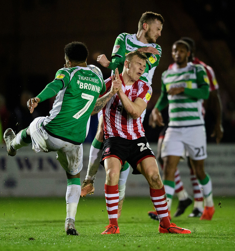 Lincoln City's Harry Anderson vies for possession with Yeovil Town's Rhys Browne<br /> <br /> Photographer Chris Vaughan/CameraSport<br /> <br /> The EFL Sky Bet League Two - Lincoln City v Yeovil Town - Friday 8th March 2019 - Sincil Bank - Lincoln<br /> <br /> World Copyright © 2019 CameraSport. All rights reserved. 43 Linden Ave. Countesthorpe. Leicester. England. LE8 5PG - Tel: +44 (0) 116 277 4147 - admin@camerasport.com - www.camerasport.com