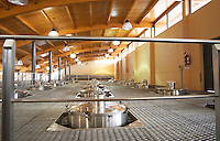 The winery with many big stainless steel fermentation tanks. View from the top. Bodega Familia Schroeder Winery, also called Saurus, Neuquen, Patagonia, Argentina, South America