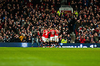 Saturday 11 January 2014 Pictured: Manchester United celebrate their second half goal  <br /> Re: Barclays Premier League Manchester Utd v Swansea City FC  at Old Trafford, Manchester