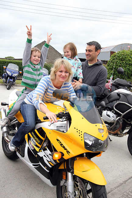"Teacher Claire Bexon with her family Charlie, Emily and Paul before the ""Run of the Country"" Motorcycle fundraiser at St.Itas school...(Photo credit should read Jenny Matthews www.newsfile.ie)....This Picture has been sent you under the conditions enclosed by:.Newsfile Ltd..The Studio,.Millmount Abbey,.Drogheda,.Co Meath..Ireland..Tel: +353(0)41-9871240.Fax: +353(0)41-9871260.GSM: +353(0)86-2500958.email: pictures@newsfile.ie.www.newsfile.ie."