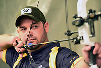 NWA Democrat-Gazette/FLIP PUTTHOFF <br /> Richard Bowen eyes a target during a practice session in March 2018 at the Outdoor America indoor archery range in Springdale. Bowen, who lives near Rogers, is one of the top target archers in the United States