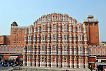 Hawa Mahal or Palace of the Winds was built in 1799 by Maharaja Pratap Singh and designed by Lal Chand Ustad in the form of the crown of Lord Krishna.Built of red and pink sandstone it has 953 small windows called jharokhas that are decorated with intricate latticework.The original intention of the lattice was to allow royal ladies to watch everyday life in the street below without being seen,since they had to observe strict purdah (face cover). The facade is part of the City Palace complex in the old part of Jaipur in Rajasthan,India.