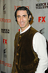JORDI CABALLERO. Arrivals to the premiere screening of the FX original drama series, Justified, at the Directors Guild of America. Los Angeles, CA, USA. March 8, 2010.