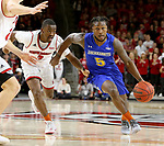 VERMILLION, SD - JANUARY 24: David Jenkins Jr. #5 from South Dakota State University drives to the basket past Triston Simpson #3 from the University of South Dakota during their game Wednesday night at the Sanford Coyote Sports Center in Vermillion, SD. (Photo by Dave Eggen/Inertia)