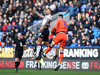 Bolton Wanderers' Josh Magennis competing with Millwall's Jake Cooper <br /> <br /> Photographer Andrew Kearns/CameraSport<br /> <br /> The EFL Sky Bet Championship - Bolton Wanderers v Millwall - Saturday 9th March 2019 - University of Bolton Stadium - Bolton <br /> <br /> World Copyright © 2019 CameraSport. All rights reserved. 43 Linden Ave. Countesthorpe. Leicester. England. LE8 5PG - Tel: +44 (0) 116 277 4147 - admin@camerasport.com - www.camerasport.com