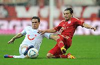 FUSSBALL   1. BUNDESLIGA  SAISON 2011/2012   27. Spieltag FC Bayern Muenchen - Hannover 96       24.03.2012 Manuel Schmiedebach (li, Hannover 96) gegen Danijel Pranjic (FC Bayern Muenchen)