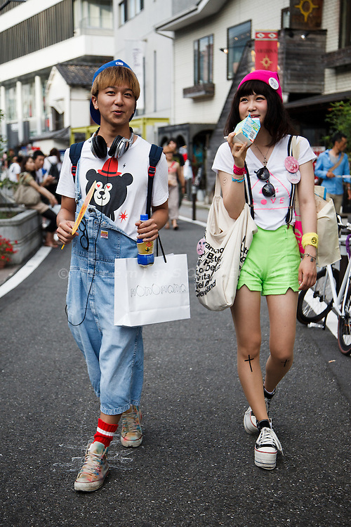 Tokyo, July 2012 - Fashionable couple walking on Cat street in the Harajuku area