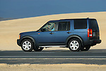 Spain, Canary Islands, Fuerteventura, nr. Corralejo. Parque Natural de los Dunas de Corralejo. Land Rover Discovery 3. --- No releases available. Automotive trademarks are the property of the trademark holder, authorization may be needed for some uses.