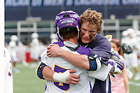 Yale All-American Ben Reeves hugs Albany All-American Connor Fields (#5) after Yale defeats UAlbany 20-11 in the NCAAA semifinal game at Gillette Stadium, May 26.