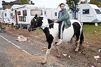 4/10/2010. A traveler boy rides his horse near the camp site at the Ballinasloe Horse Fair, Ballinasloe, Ireland. Picture James Horan