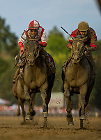 SARATOGA SPRINGS, NY - AUGUST 26: McCraken #9, ridden by Brian Hernandez and Cloud Computing #1, ridden by Javier Castellano battle in the Travers Stakes at Saratoga Race Course on August 26, 2017 in Saratoga Springs, New York.(Photo by Alex Evers/Eclipse Sportswire/Getty Images)