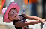 Zoey Brown, 4, of Salem, Ore., watches the 54th International Camel Race in Virginia City, Nev., on Friday, Sept. 6, 2013.  <br /> Photo by Cathleen Allison