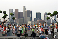 Runner start the 2010 Honda LA Marathon, running the new race route around Dodger Stadium Los Angeles Skyline visible in background, Sunday, March 21, 2010 in Los Angeles, Calif.(AP Photo/Spencer Weiner).
