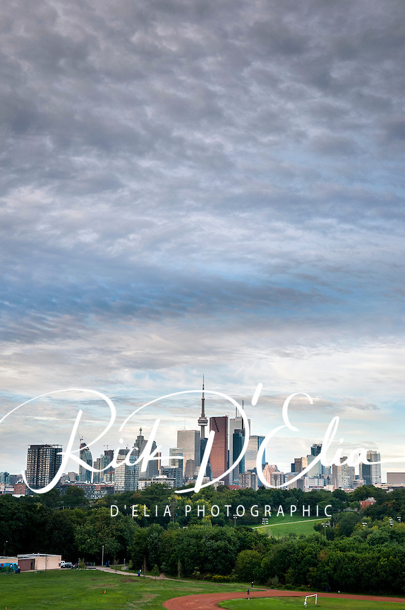 Toronto skyline from Riverdale Park in the suburbs north of downtown looking toward Lake Erie. The view includes the CN Tower, the tallest freestanding structure in the western hemisphere. The iconic communications and observation tower rises to 1,815 feet/553 meters snd was completed in 1976. The tower is among the modern Seven Wonders of the World compiled by the American Society of Civil Engineers.