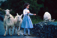 Irish girl with her goats, Ballingeary, County Cork, Ireland