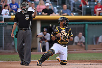 Luis Martinez (20) of the Salt Lake Bees behind the plate with home plate umpire Brian Reilly in action against the Fresno Grizzlies at Smith's Ballpark on May 25, 2014 in Salt Lake City, Utah.  (Stephen Smith/Four Seam Images)