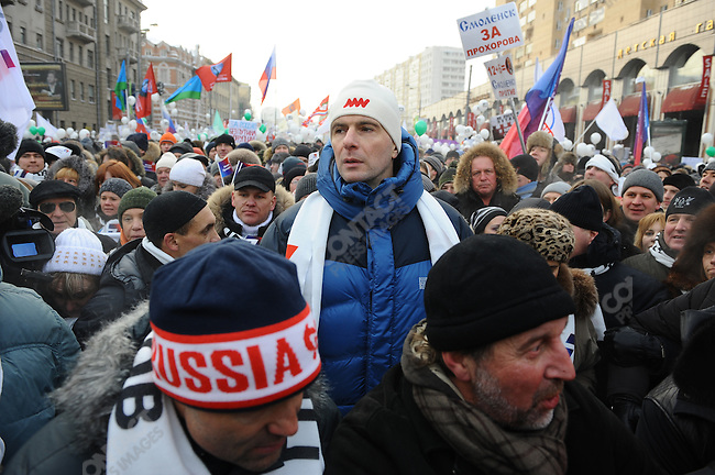 Tens of thousands came to an opposition rally in Moscow a month before the upcoming Russian presidential elections to protest against the Putin administration and for honest elections despite freezing temperatures dipping to -4 farenheit. Presidential candidate Mikhail Prokhorov towered over many of the other protesters. Russia, February 4, 2012