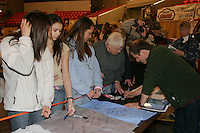 Thursday March 3, 2006  Anchorage, Alaska   Musher Ramey Smyth signs autographs for race fans at the musher's pre-race drawing and banquet, the largest banquet in Alaska at the Eagan Center.