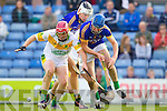 Pat Corridan Lixnaw in action against Sean Maunsell Kilmoyley in the County Senior Hurling final at Austin Stack Park on Saturday.