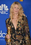 a_ Laura Dern poses in the press room with awards at the 77th Annual Golden Globe Awards at The Beverly Hilton Hotel on January 05, 2020 in Beverly Hills, California.