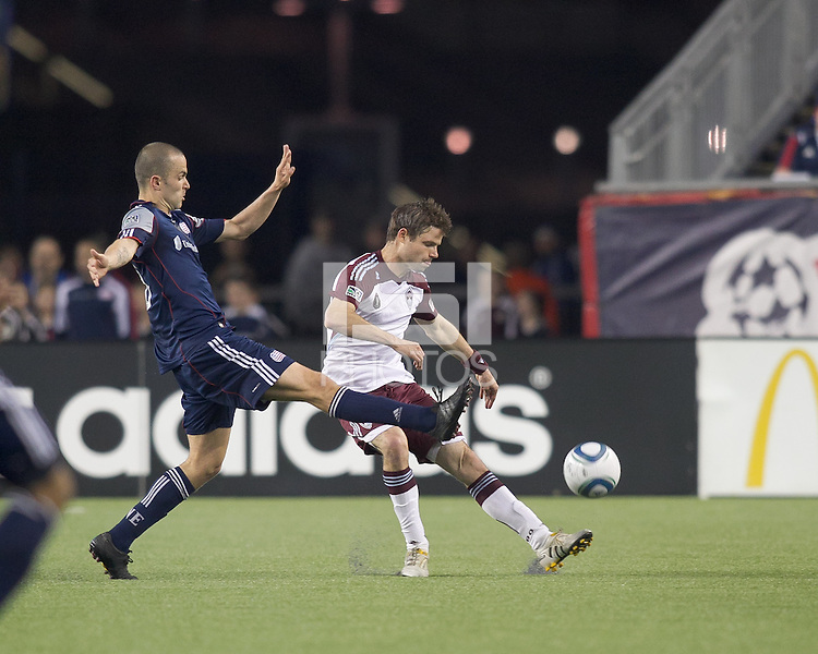 Colorado Rapids defender Drew Moor (3) passes the ball as New England Revolution forward Rajko Lekic (10) defends. In a Major League Soccer (MLS) match, the New England Revolution tied the Colorado Rapids, 0-0, at Gillette Stadium on May 7, 2011.
