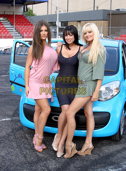 LUCY PINDER, SOPHIE HOWARD & MICHELLE MARSH.At Max Power Live, NEC Birmingham, .July 1st 2005..full length blue car girls.Ref: JEZ.www.capitalpictures.com.sales@capitalpictures.com.©Jez Self/Capital Pictures