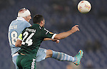 Calcio, Europa League: Lazio vs Panathinaikos. Roma, stadio Olimpico, 8 novembre 2012..Lazio forward Libor Kozak, of Czech Republic, and Panathinaikos defender Loukas Vyntra, right, jump for the ball during the Europa League Group J football match between Lazio and Panathinaikos, at Rome's Olympic stadium, 8 november 2012..UPDATE IMAGES PRESS/Riccardo De Luca