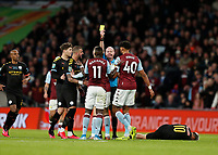 1st March 2020; Wembley Stadium, London, England; Carabao Cup Final, League Cup, Aston Villa versus Manchester City; Referee Lee Mason gives a yellow card to Marvelous Nakamba of Aston Villa mistakingly after Sergio Aguero of Manchester City fouls Marvelous Nakamba of Aston Villa  - Strictly Editorial Use Only. No use with unauthorized audio, video, data, fixture lists, club/league logos or 'live' services. Online in-match use limited to 120 images, no video emulation. No use in betting, games or single club/league/player publications