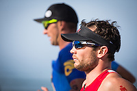Ben Hoffman and Matt Reed run down the strand in the Accenture Ironman California 70.3 in Oceanside, CA on March 29, 2014.