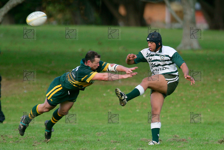 Kevin Farrell tries to charge down the clearing kick of T. Ropotini. Counties Manukau Premier Club Rugby, Pukekohe v Manurewa  played at the Colin Lawrie field, on the 17th of April 2006. Manurewa won 20 - 18.