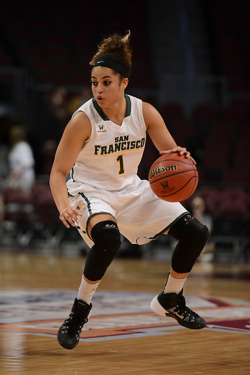 March 6, 2014; Las Vegas, NV, USA; San Francisco Lady Dons guard Zhane Dikes (1) dribbles against the Loyola Marymount Lions during the first half of the WCC Basketball Championships at Orleans Arena.