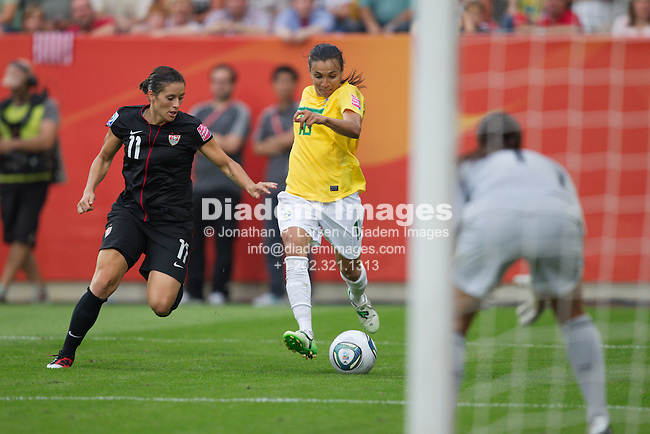 DRESDEN, GERMANY - JULY 10:  Marta of Brazil (R) drives the ball against Alex Krieger of the United States (L) during the FIFA Women's World Cup quarterfinal match at Rudolf Harbig Stadium on July 10, 2011 in Dresden, Germany.  Editorial use only.  Commercial use prohibited.  No push to mobile device usage.  (Photograph by Jonathan P. Larsen)