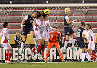 BOCA RATON, FL - DECEMBER 15, 2012: Abby Wambach (14) of the USA WNT goes up for a header with Han Peng (18) and Zhang Rui (25) of China WNT during an international friendly match at FAU Stadium, in Boca Raton, Florida, on Saturday, December 15, 2012. USA won 4-1.