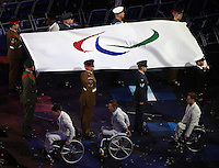 PICTURE BY JOSEPH JOHNSON/photosport.co.nz/SWPIX.COM - 2012 London Paralympic Games - Opening Ceremony - Olympic Stadium, Olympic Park, London, England - 29/08/12 - Paralympic Games flag brought into the stadium by eight members of the Great Britain U22 Wheelchair Basketball team handing it over to Royal Navy, Army and Royal Air Force personel.