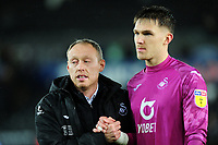 Steve Cooper Head Coach of Swansea City shakes hands with Freddie Woodman of Swansea City during the Sky Bet Championship match between Swansea City and Charlton Athletic at the Liberty Stadium in Swansea, Wales, UK.  Thursday 02 January 2020