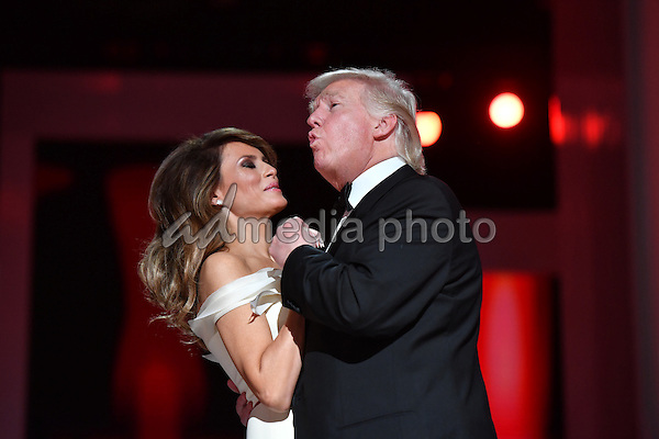 President Donald Trump sings along with the music as he dances with First Lady Melania Trump at the Liberty Ball at the Washington Convention Center on January 20, 2017 in Washington, D.C. Trump will attend a series of balls to cap his Inauguration day. Photo Credit: Kevin Dietsch/CNP/AdMedia