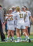 25 April 2015: University of Vermont Catamount Attacker Alex Bernier, a Sophomore from Falmouth, Maine, celebrates a goal with teammates during a game against the University of New Hampshire Wildcats at Virtue Field in Burlington, Vermont. The Lady Catamounts defeated the Lady Wildcats 12-10 in the final game of the season, advancing to the America East playoffs. Mandatory Credit: Ed Wolfstein Photo *** RAW (NEF) Image File Available ***