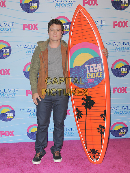 Josh Hutcherson.Teen Choice Awards 2012 - Press Room held at Gibson Amphitheatre, Universal City, California, USA..July 22nd, 2012.full length brown beige jacket sleeveless leather grey gray top jeans denim surfboard .CAP/RKE/DVS.©DVS/RockinExposures/Capital Pictures.