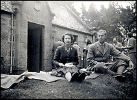 BNPS.co.uk (01202 558833)Pic:    Rowley's/BNPS<br /> <br /> Princess Elizabeth and Prince Philip, seated on a blanket, having a picnic near Balmoral.<br /> <br /> Two previously unknown poems by celebrated writer Daphne du Maurier have been discovered hidden inside a photograph frame.<br /> <br /> They are believed to have been penned in the late 1920s, when she was in her early 20s and an unknown in the literary world.<br /> <br /> The poems were written on a carefully folded sheet of A4 paper concealed within a 5ins high blue leather frame which contained a photo of du Maurier in a swimming costume. <br /> <br /> They were uncovered by an eagle-eyed auctioneer who has been tasked with selling an archive of du Maurier's letters and photos, which includes snaps with the Royals.