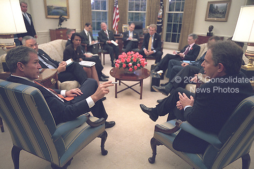 United States President George W. Bush meets with Prime Minister Tony Blair of Great Britain in the Oval Office of the White House in Washington, D.C. on Wednesday, November 7, 2001.  Also visible in the photo are U.S. Secretary of State Colin Powell and National Security Advisor Condoleezza Rice..Mandatory Credit: Eric Draper - White House via CNP.