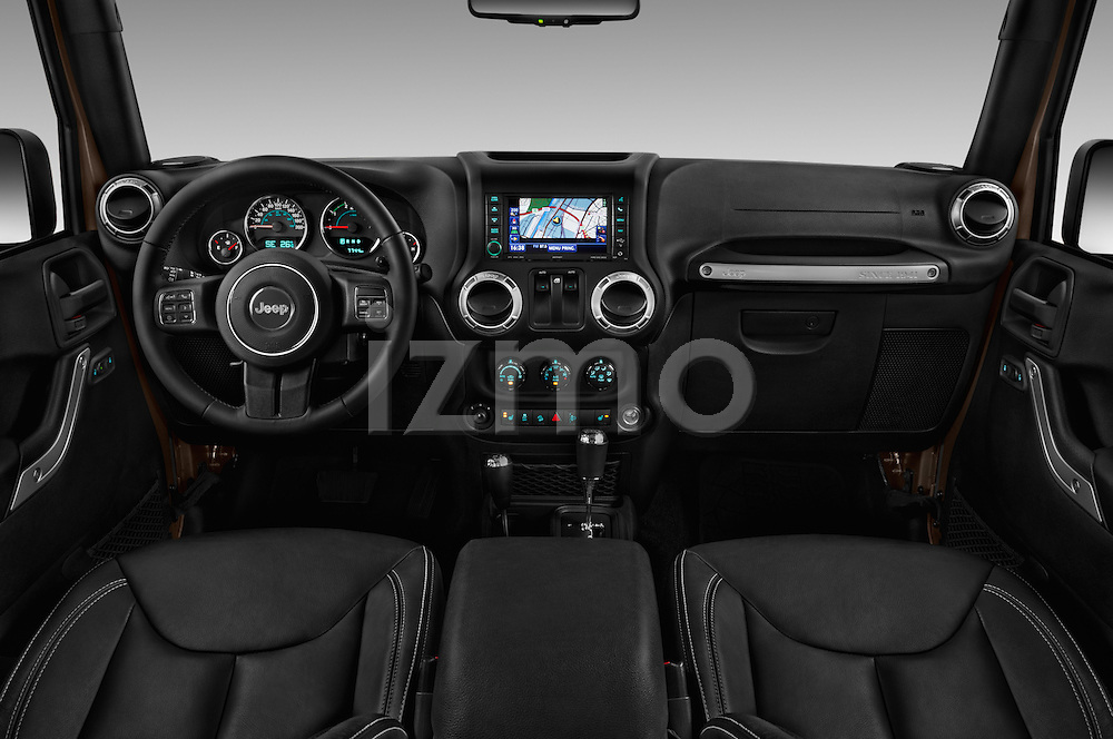 Stock photo of straight dashboard view of 2016 JEEP Wrangler Sahara 5 Door SUV Dashboard