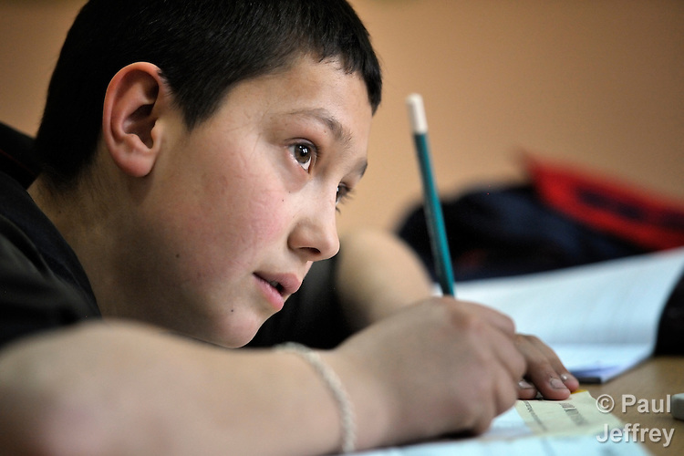 A boy in class at the Branko Pesic School, an educational center for Roma children and families in Belgrade, Serbia, which is supported by Church World Service. Many of the students' families came to Belgrade as refugees from Kosovo. Many of them lack legal status in Serbia, and thus have difficulty obtaining formal employment and accessing government services.